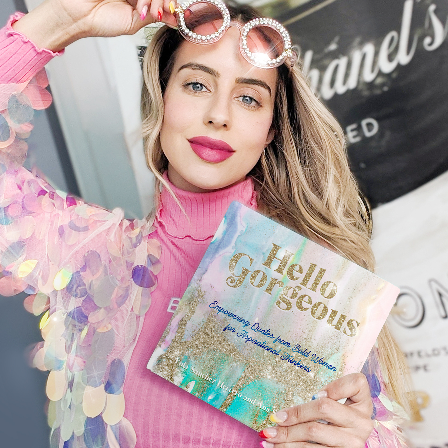 Image of founder and author Lola Sanchez showcasing her new book Hello Gorgeous.