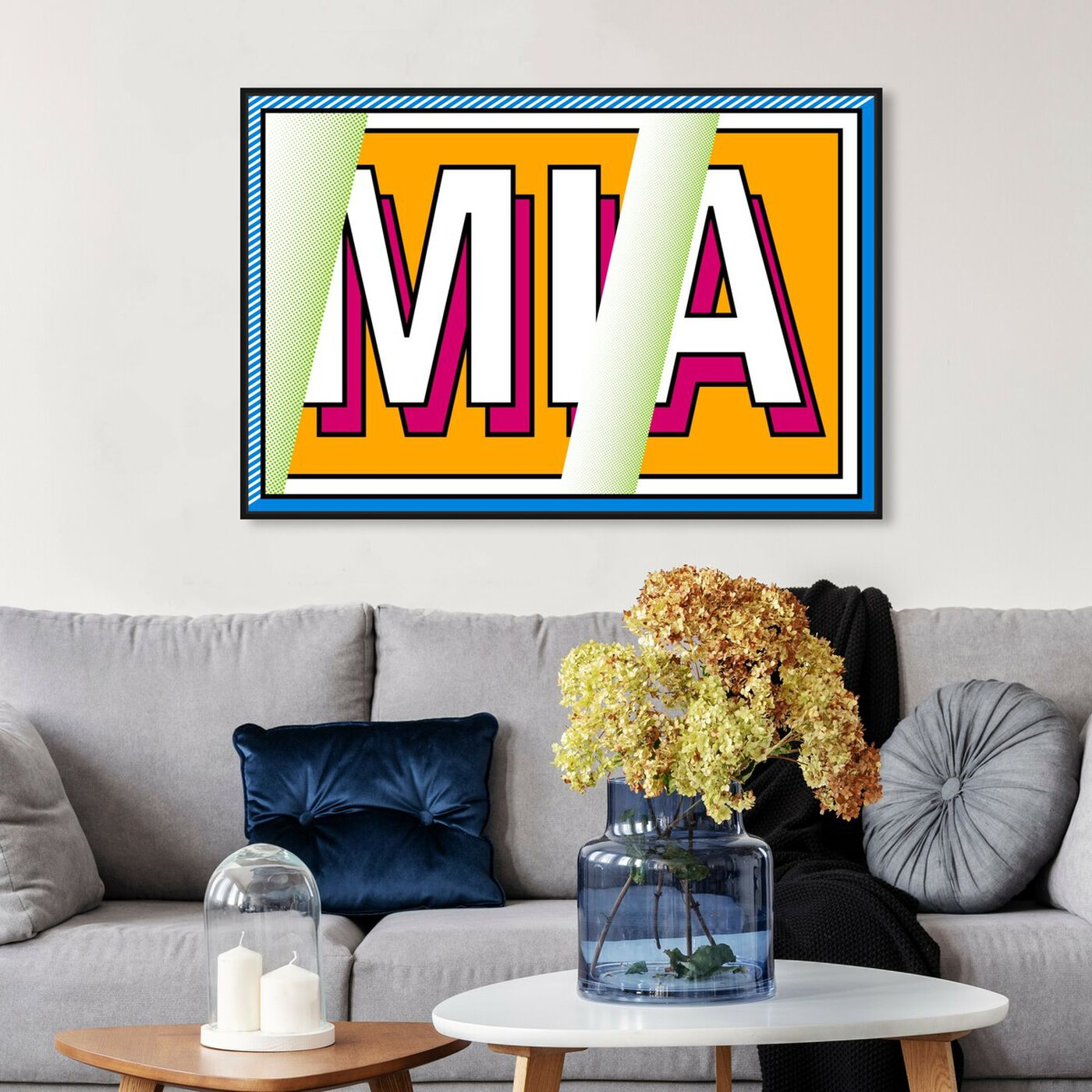 Hanging view of M-I-A featuring advertising and comics art.