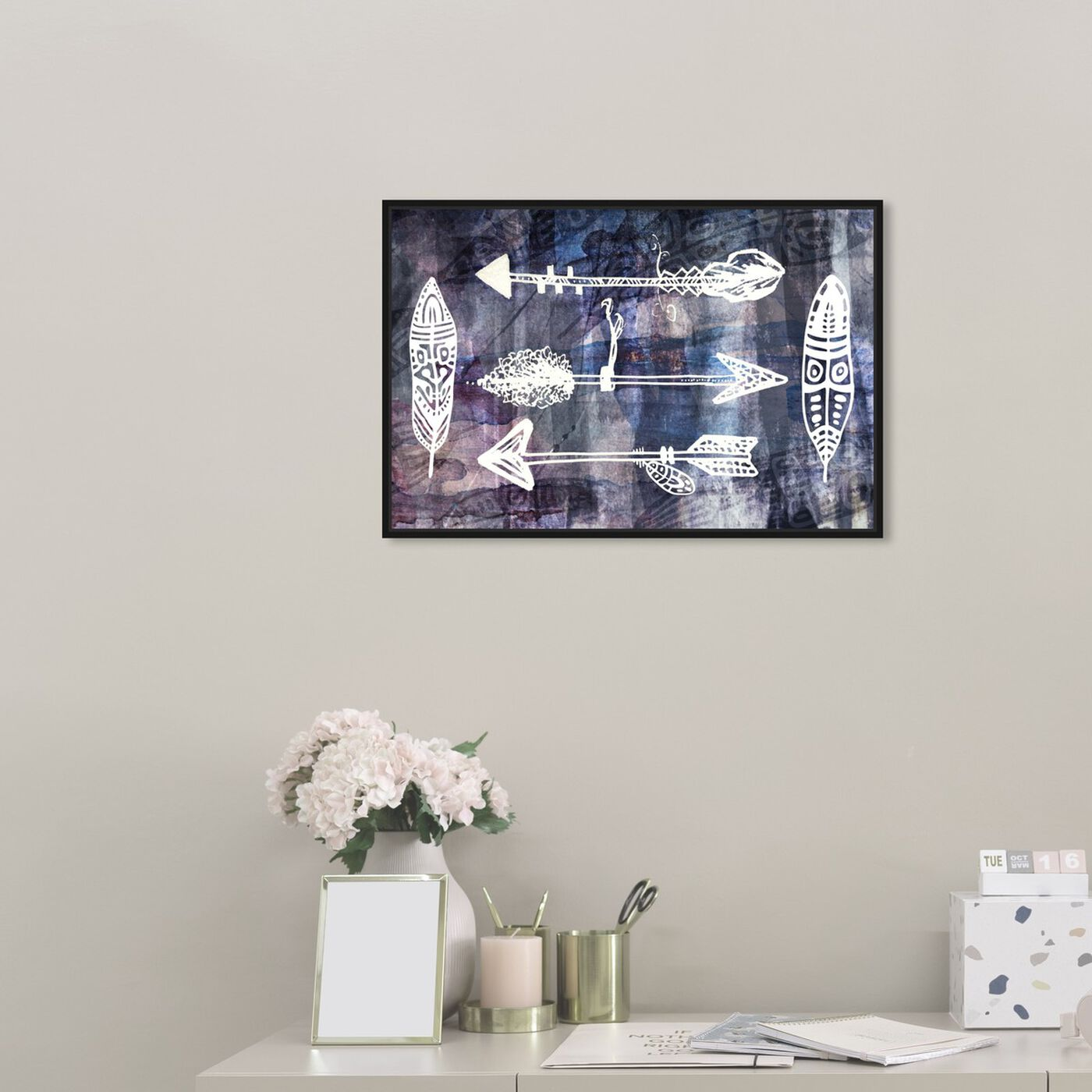 Hanging view of Ethnica featuring symbols and objects and shapes art.