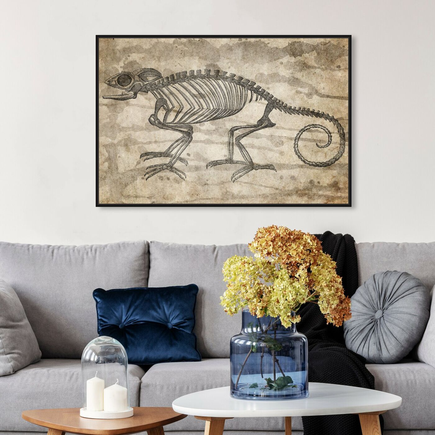 Hanging view of Karma Chameleon featuring animals and skeletons art.