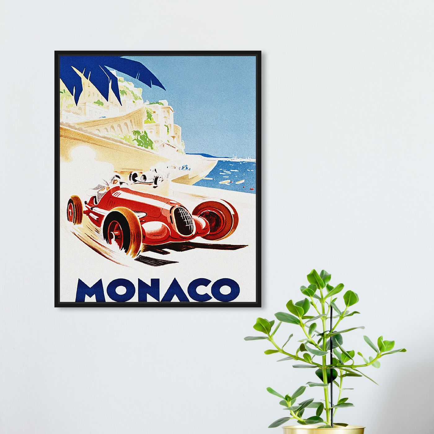 Hanging view of Monaco Grand Prix featuring advertising and posters art.